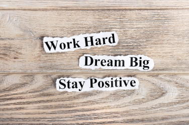 Work Hard Dream Big Stay Positive text on paper. Word Work Hard Dream Big Stay Positive on torn paper. Concept Image.
